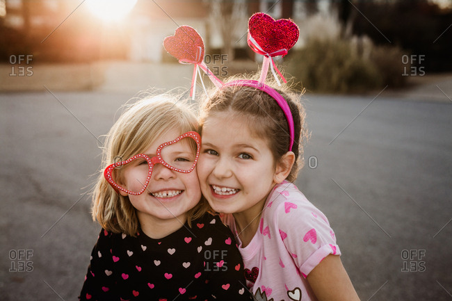 Two girls smiling in valentine's day themed clothes and accessories