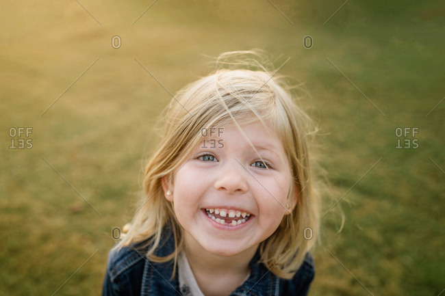 Little girl with a missing a tooth