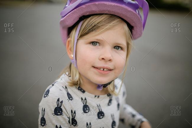 Little girl wearing a helmet