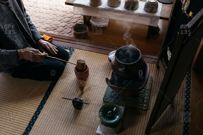 Person preparing a traditional Japanese tea ceremony
