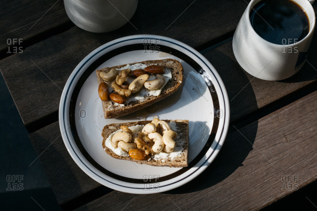Toast with mixed nuts and honey served with coffee
