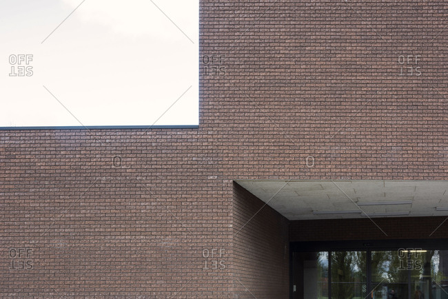 Architectural detail of the corner angle of a modern brick building