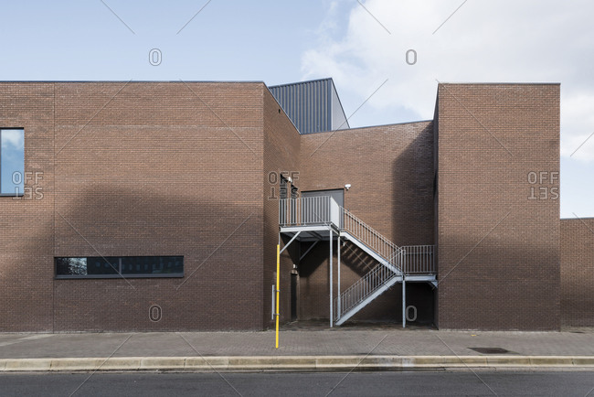 Exterior of modern brick building with staircase