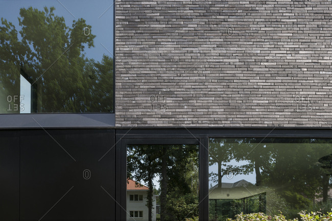 Reflections in exterior window of modern brick house