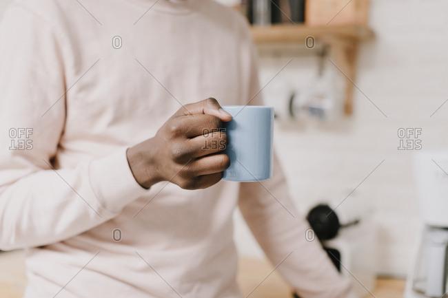 Close up of a man holding a mug