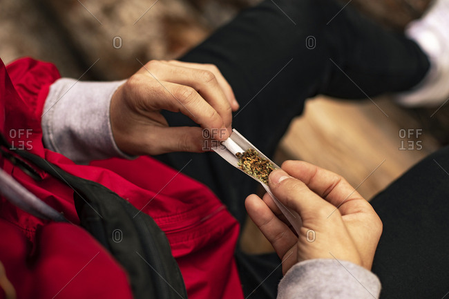 Close up of the hands of a man making joint