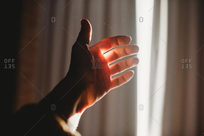 Hand catching window light