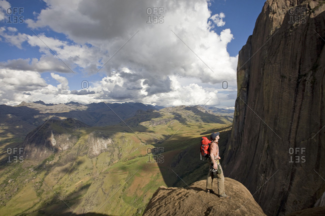April 11, 2008: Climber looks across the Tsaranoro Massif, southern Madagascar, Africa
