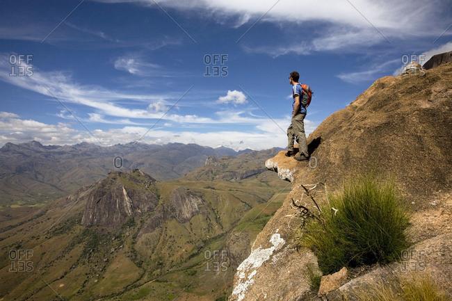 Climber looks across the Tsaranoro Massif, southern Madagascar, Africa