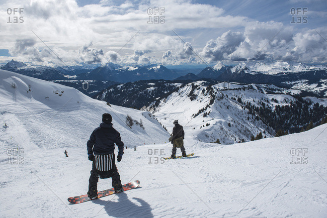 March 16, 2018: Snowboarders in the Morzine Ski Area, Port du Soleil, Auvergne Rhone Alpes, French Alps, France, Europe