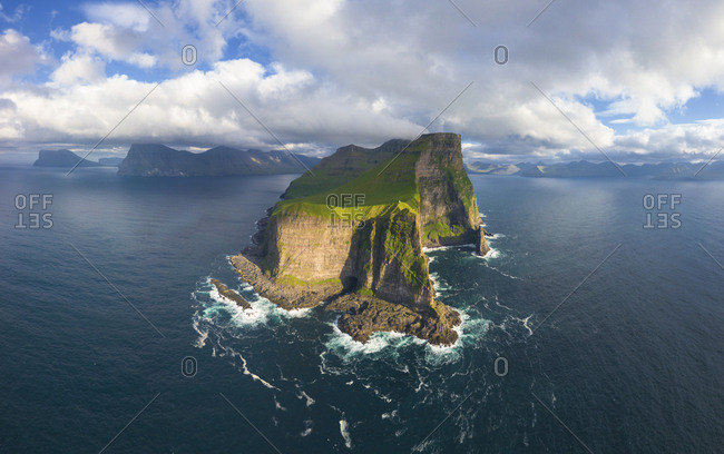 Aerial panoramic of Kallur lighthouse and cliffs, Kalsoy island, Faroe Islands, Denmark, Europe