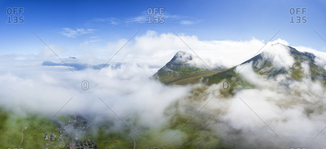 Aerial panoramic of clouds above Gjogv, Eysturoy island, Faroe Islands, Denmark, Europe
