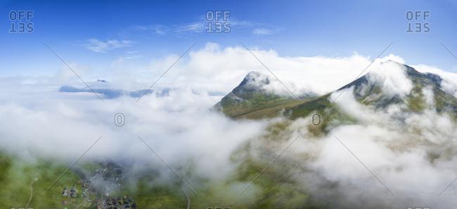 Aerial panoramic of clouds above Gjogv, Eysturoy island, Faroe Islands, Denmark, Europe