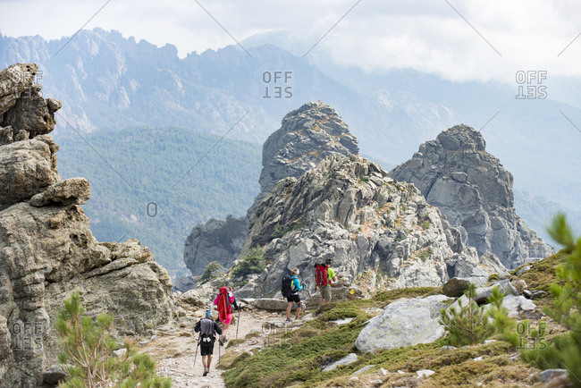 September 9, 2017: Trekking on the GR20 in Corsica near the Aiguilles de Bavella hiking towards Refuge d'Asinao, Corsica, France, Mediterranean, Europe