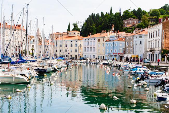 June 18, 2008: Historic harbor with boats, Piran, Slovenia, Europe