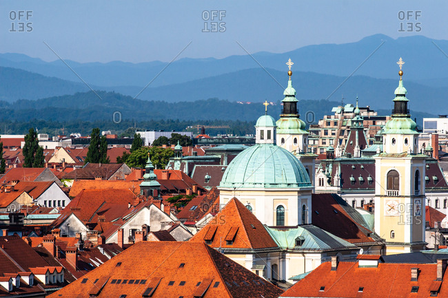 June 20, 2008: City rooftops with mountains, Ljubljana, Slovenia, Europe