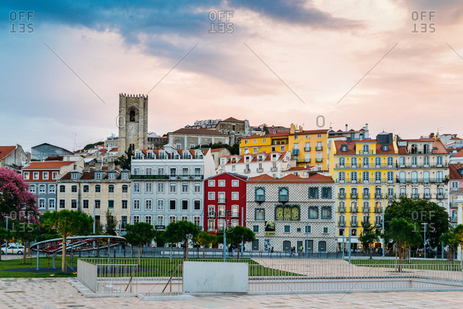 October 23, 2018: Traditional buildings with azulejo tiles in the old Lisbon neighbourhood of Alfama with Se Cathedral in background, Lisbon, Portugal, Europe