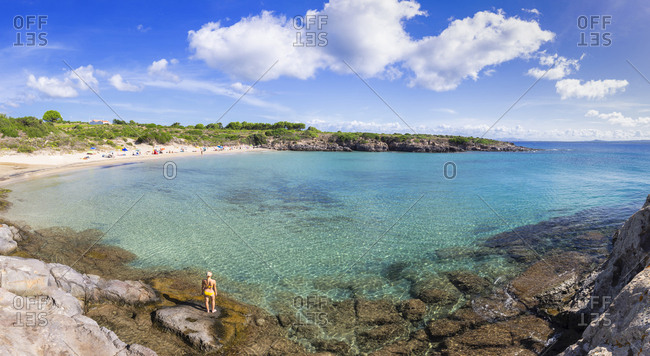 Girl in swimsuit looks at the beach, La Bobba Beach, San Pietro Island, Sud Sardegna province, Sardinia, Italy, Mediterranean, Europe