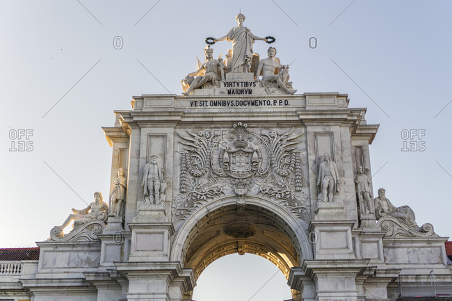 Rua Augusta triumphal Arch, statue detail with Glory rewarding Valor and Genius, seen from Commerce Square, Lisbon, Portugal, Europe