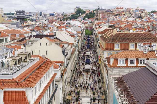 July 19, 2018: Rua Augusta seen from Arco viewpoint and pedestrian zone with traditional buildings and Santa Justa Lift to the left, Lisbon, Portugal, Europe
