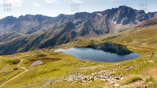 A lake at the top of the Gavia Pass, Italian Alps, Lombardy, Italy, Europe