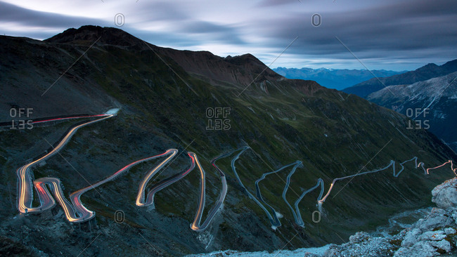 Light trails at night on The Stelvio Pass (Passo dello Stelvio), Eastern Alps, Italy, Europe