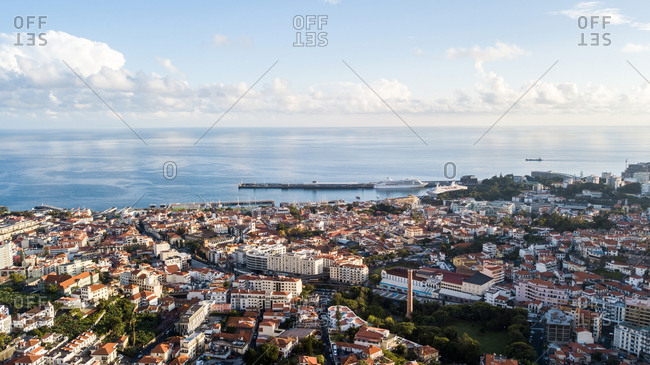 Drone aerial photography of a sunset falling over Funchal city, Madeira, Portugal, Atlantic, Europe