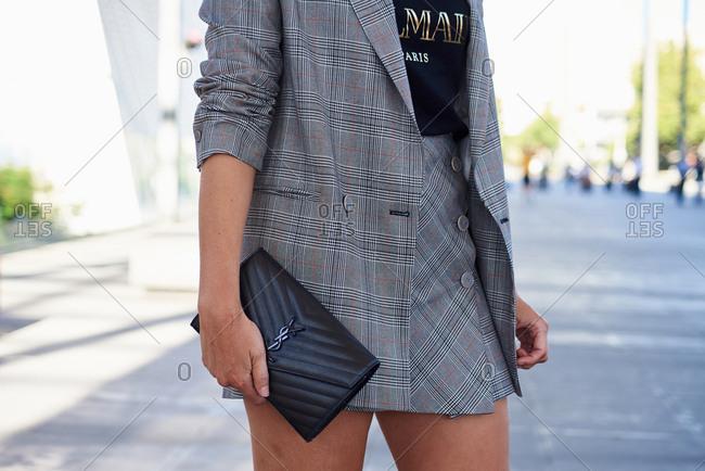 March 07, 2018- Melbourne, Australia: Fashion Show Guest holding Saint Laurent Clutch Bag at Virgin Australia Melbourne Fashion Festival