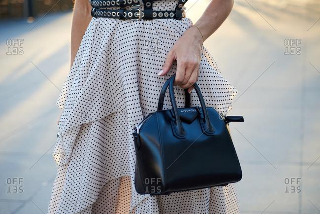March 07, 2018- Melbourne, Australia: Stylish Woman holding mini Givenchy Small Bag at Virgin Australia Melbourne Fashion Festival, Horizontal