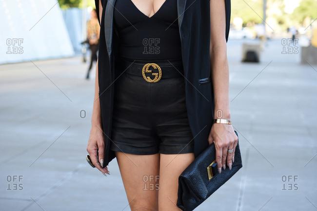 March 08, 2018- Melbourne, Australia: Woman Wears Gucci Belt and Louis Vuitton Clutch Bag at Virgin Australia Melbourne Fashion Festival, Horizontal