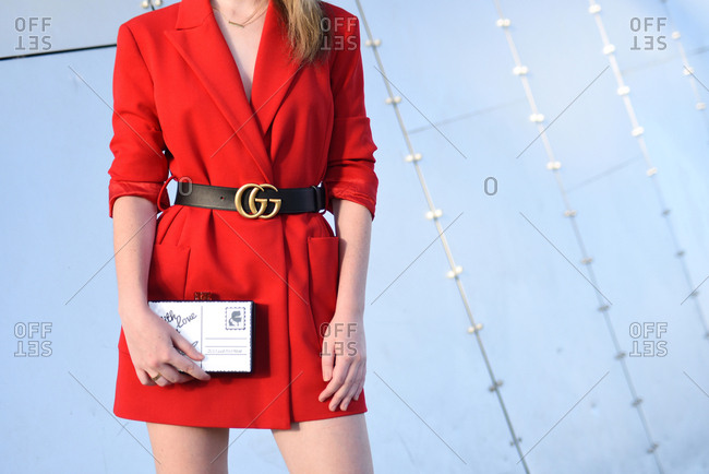 March 08, 2018- Melbourne, Australia: Young Woman Wears Red Blazer, Gucci Belt and Karl Lagerfeld clutch bag at Virgin Australia Melbourne Fashion Festival, Horizontal