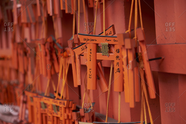 Fushimi Inari-Taisha, Kyoto Prefecture, Japan- April 5, 2017: Tourists and worshippers leave messages on the shrine wall