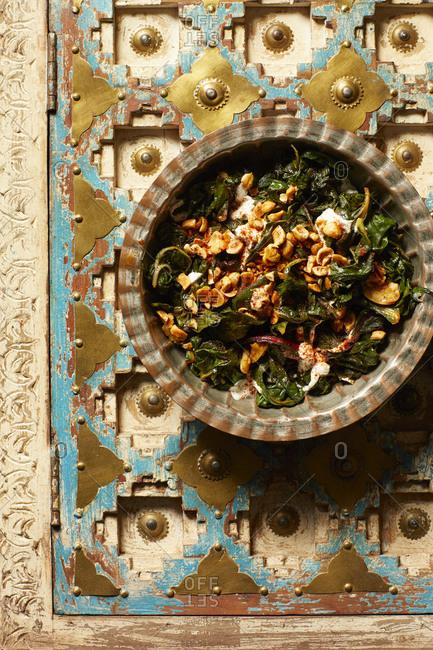 Bakoula salad with yogurt and spiced hazelnuts