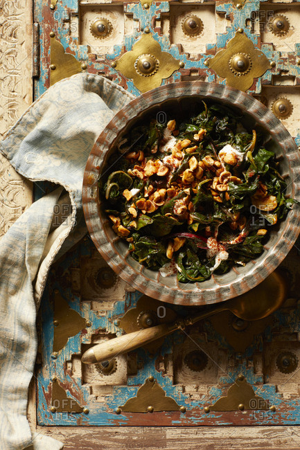 Overhead view of bakoula salad with yogurt and spiced hazelnuts