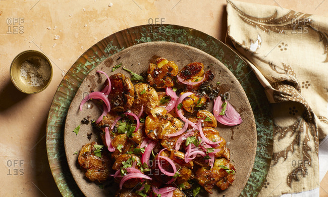 Chermoula smashed potatoes with pickled onions