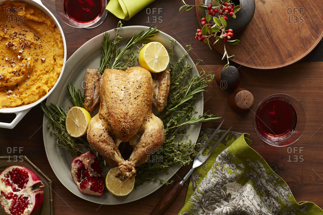 Roasted chicken for Thanksgiving dinner party with lemon and pomegranate