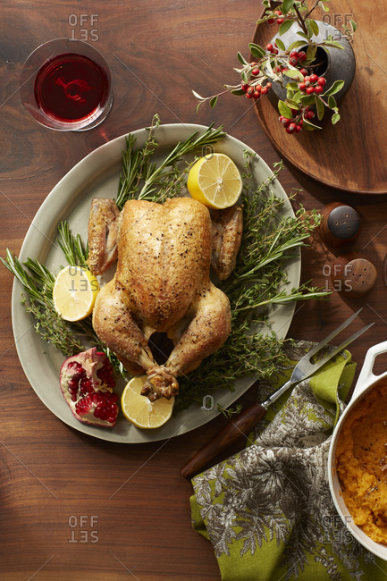 Roasted chicken for Thanksgiving dinner party and red wine