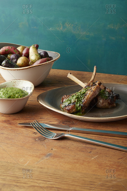 Grilled meat with chimichurri sauce and roasted potatoes