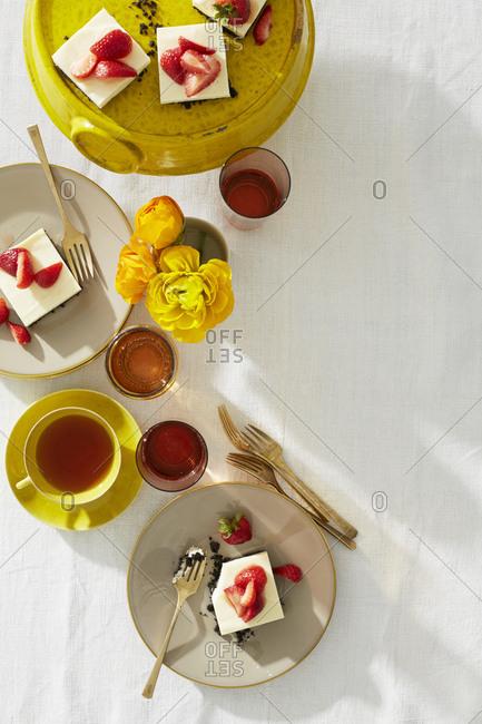 Lemon icebox cake served with wine and tea