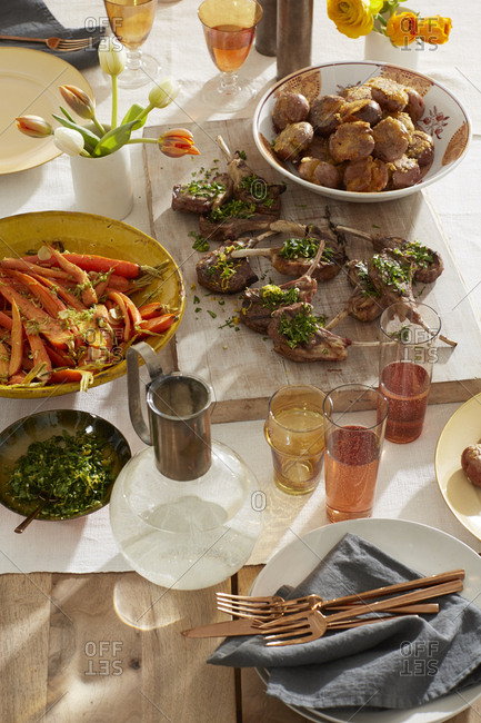 Lemony grilled lamb chops with roasted carrots and potatoes, rose wine