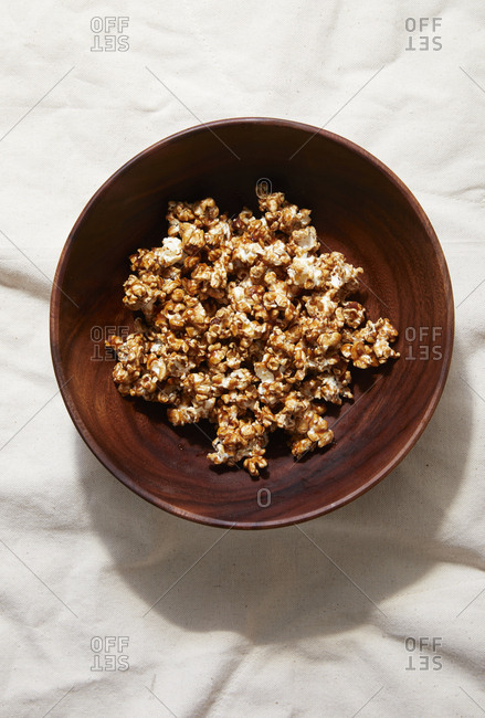 Carmel popcorn in wooden bowl