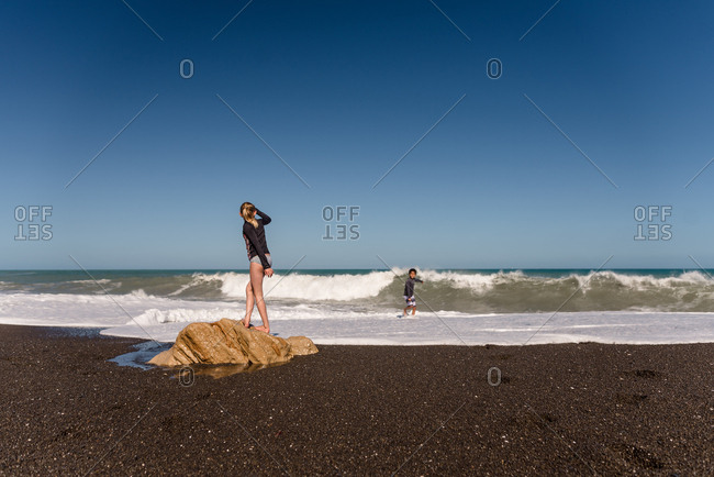 Kids playing on a beach in New Zealand