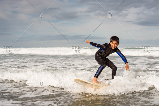 Boy riding a wave on a surfboard
