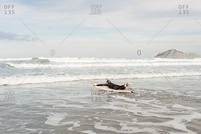 Girl paddling on a surfboard