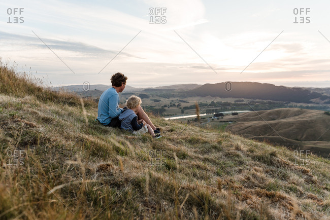 Father and son sitting on Te Mata Peak, New Zealand