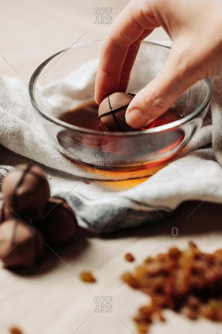 Woman preparing chocolate pralines