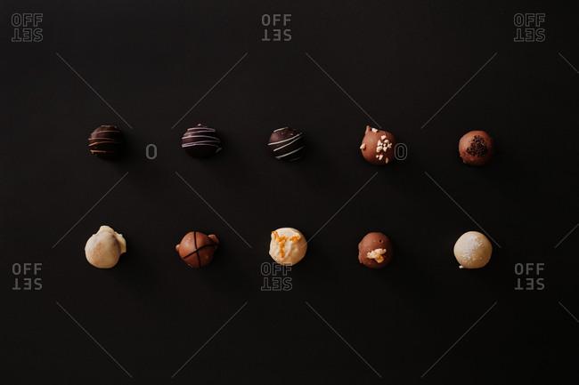 Variety of chocolate pralines  on dark background