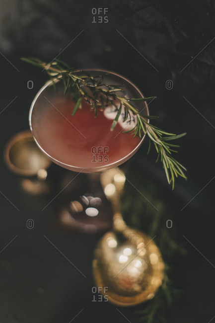 Elevated view of a misty cocktail with torched rosemary garnish
