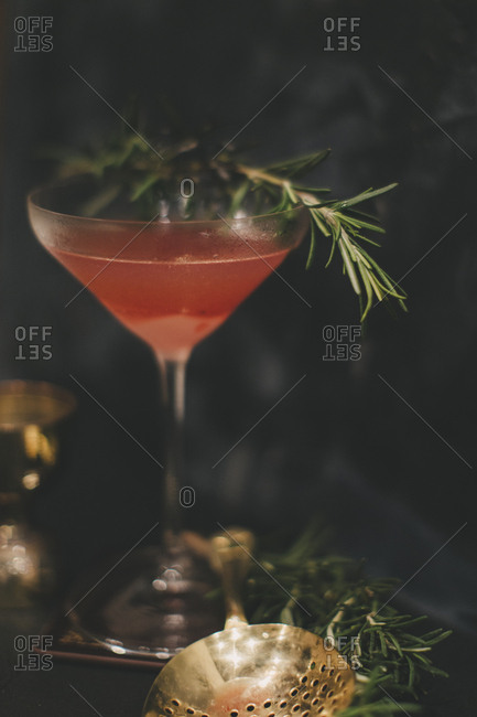 Cocktail with torched rosemary garnish
