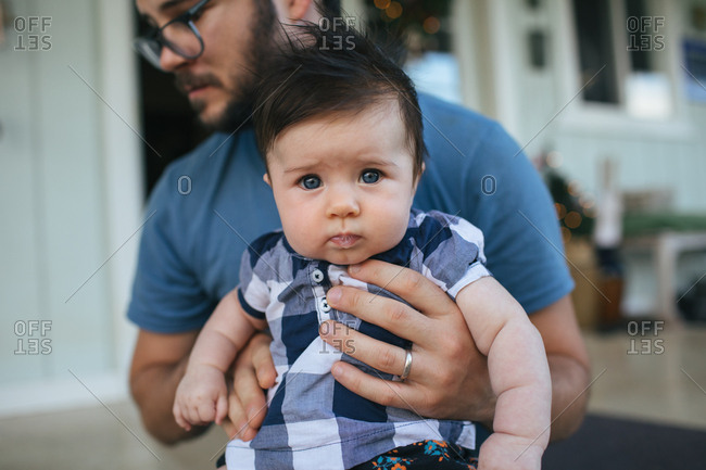 Father and baby daughter outside house